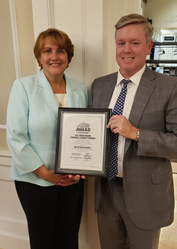 Michelle Nealey, Chief Financial Officer of 1st Advantage and Paul W. Muse, President and CEO of 1st Advantage accepting the credit union's Dora Maxwell Award